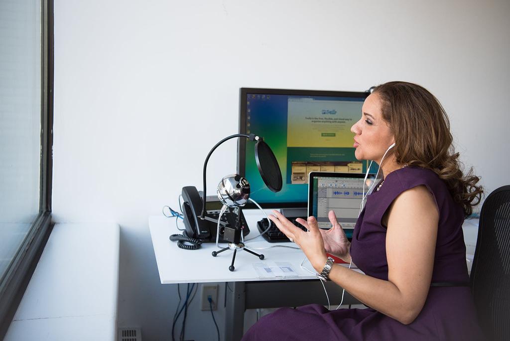 Internet Marketing Woman Wearing Purple Dress Sitting On Chair Near Window