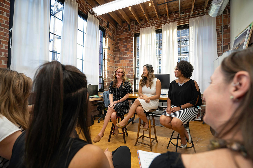 Internet Advertising Women Sitting On Chairs Inside A Room